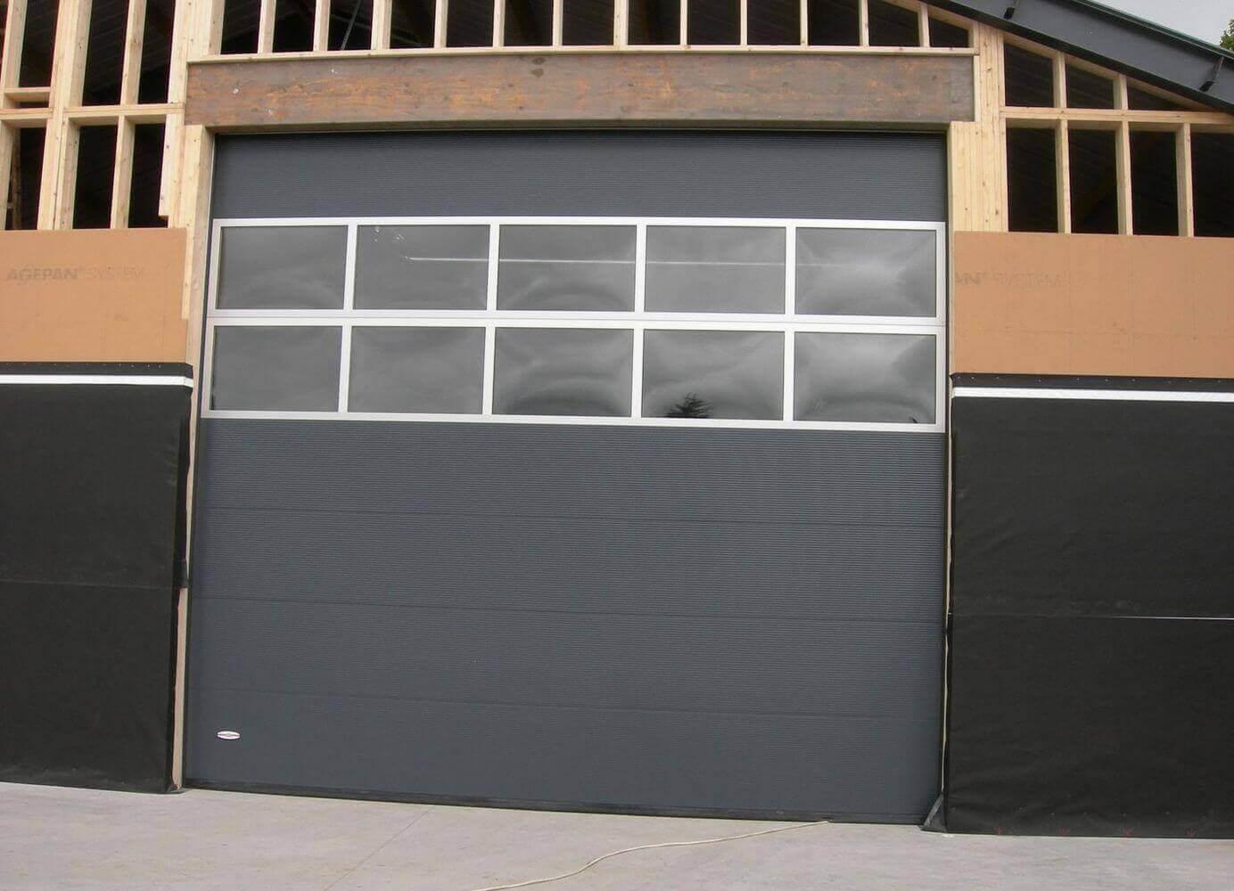 Installation portes sectionnelles vitrées hall ABF Fermetures